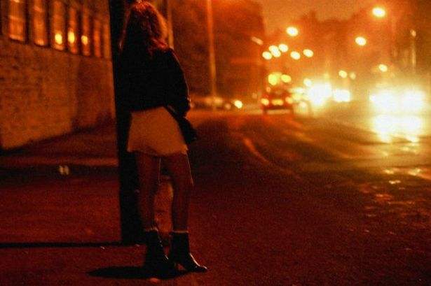 a prostitute working city streets at night 431035703