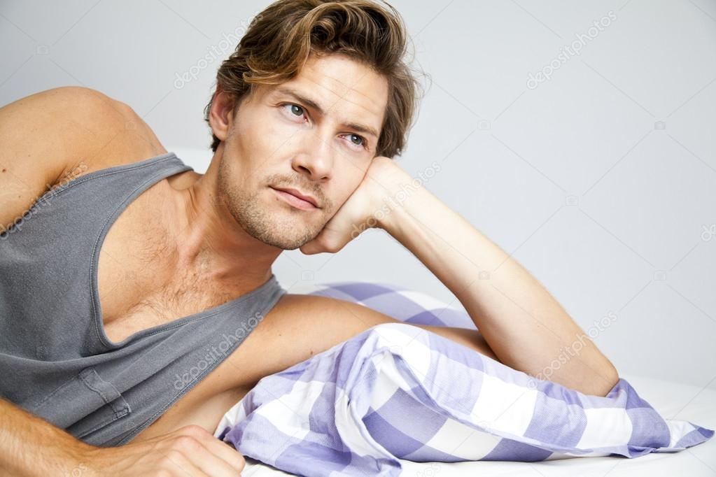 depositphotos 30822731 stock photo young man lying in bed