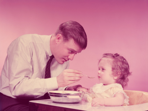 h armstrong roberts father feeding baby girl sitting i